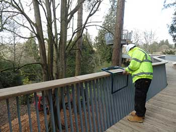Interpretation being clamped to the balustrade of the walkway